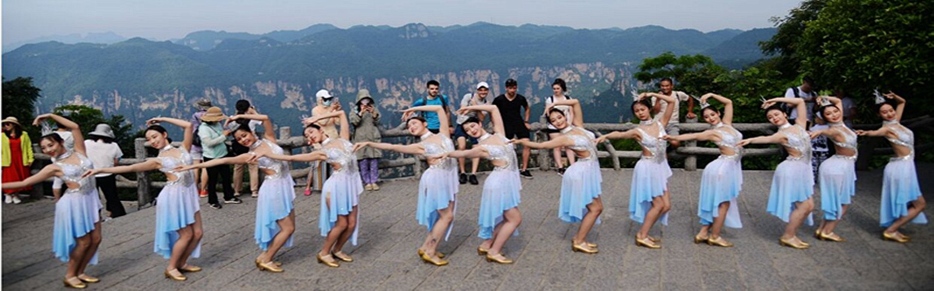 Actresses from Zhangjiajie Romantic Show dance in Tianzi Mountain