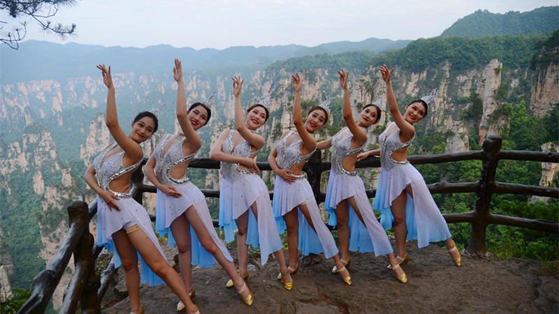 Actresses from Zhangjiajie Romantic Show dance in Tianzi Mountain